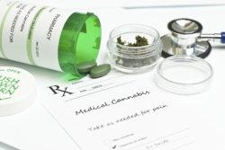 Medical marijuana prescription with bottle and stethoscope.